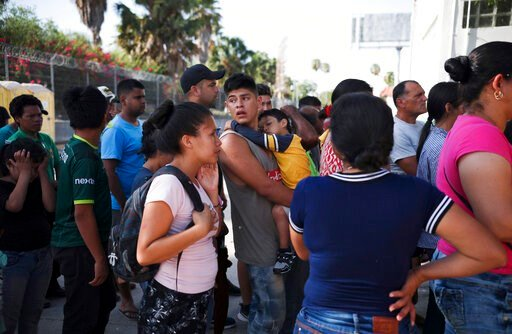 (AP Photo/Emilio Espejel. File). FILE - In this Aug. 1, 2019 file photo, migrants line up in Matamoros, Mexico, for a meal donated by volunteers from the U.S., at the foot of the Puerta Mexico bridge that crosses to Brownsville, Texas. A federal appeal...