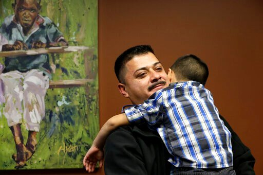 (AP Photo/Elaine Thompson, File). FILE - In this Friday, Oct. 17, 2014 file photo, Ignacio Lanuza-Torres holds his son, Isaiah, 4, during a portrait session in Seattle. Lanuza-Torres, a Mexican immigrant who was nearly deported after a U.S. Immigration...