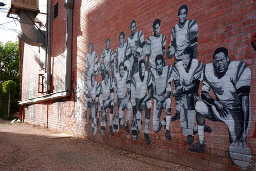 (AP Photo/Mead Gruver). In this Wednesday, Sept. 11, 2019 photo shows part of an alleyway mural in downtown Laramie, Wyo., that honors the Black 14. The Black 14 were black athletes dismissed from the University of Wyoming football team in 1969 for see...