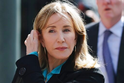 (AP Photo/Charles Krupa, File). FILE - In this April 3, 2019 file photo, actress Felicity Huffman arrives at federal court in Boston to face charges in a nationwide college admissions bribery scandal. Huffman, who pleaded guilty to a single count of co...
