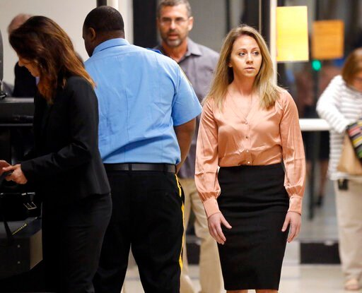 (Tom Fox/The Dallas Morning News via AP). CORRECTS DATE TO SEPT. 13 -Fired Dallas police Officer Amber Guyger, right, arrives for jury selection in her murder trial at the Frank Crowley Courthouse in downtown Dallas, Friday, Sept. 13, 2019. Guyger shot...