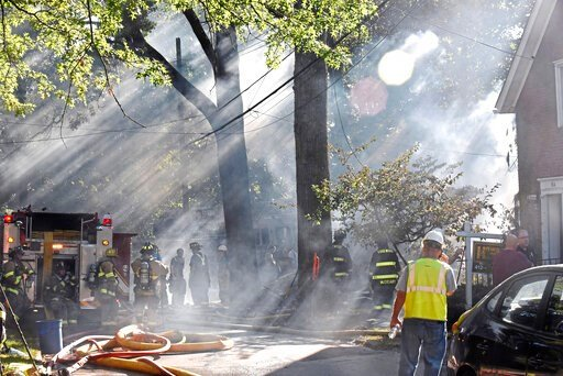 (Christian Snyder/Pittsburgh Post-Gazette via AP). First responders work at the scene of a house fire in Edgewood, Pa,. on Saturday, Sept. 14, 2019. Flames were reported at two homes Saturday afternoon in suburban Edgewood. Emergency officials say one ...
