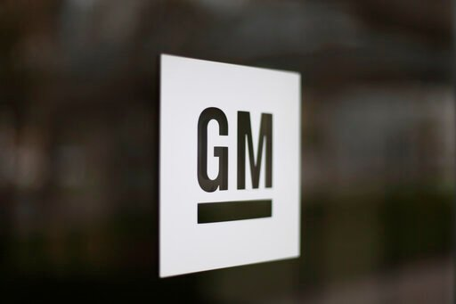 (AP Photo/Paul Sancya, File). FILE - This May 16, 2014, file photo shows the General Motors logo at the company's world headquarters in Detroit. The United Auto Workers union is letting its contract with General Motors expire just before midnight Satur...