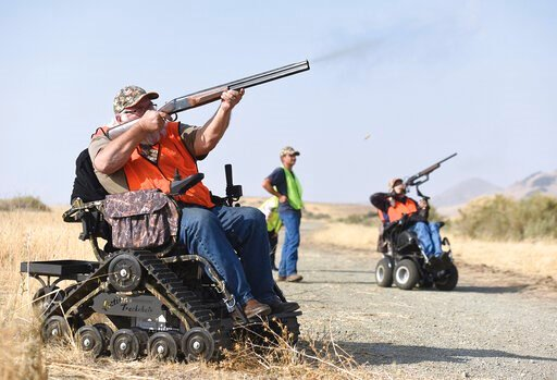 (Chieko Hara/The Porterville Recorder via AP, File). FILE - In this Nov. 16, 2018, file photo, Duane Townsend, left, shoots a pheasant at Special Friday Pheasant Hunts, sponsored by Southern Tulare County Sportsman's Association, at Lake Success Recrea...