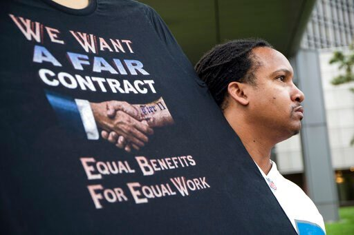 (Kathleen Galligan/Detroit Free Press via AP). Sean Crawford, of United Auto Workers 598, rallies outside the Marriott Renaissance Hotel while the UAW GM Council holds a meeting inside the hotel in Detroit, Sunday Sept. 15, 2019. The United Auto Worker...
