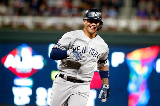 (AP Photo/Bruce Kluckhohn). New York Yankees' Gleyber Torres celebrates as he runs the bases after hitting a home run during the second inning in Game 3 of a baseball American League Division Series against the Minnesota Twins, Monday, Oct. 7, 2019, in...