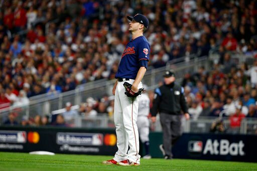 (AP Photo/Bruce Kluckhohn). Minnesota Twins starting pitcher Jake Odorizzi watches a home run hit by New York Yankees' Gleyber Torres during the second inning in Game 3 of a baseball American League Division Series, Monday, Oct. 7, 2019, in Minneapolis.