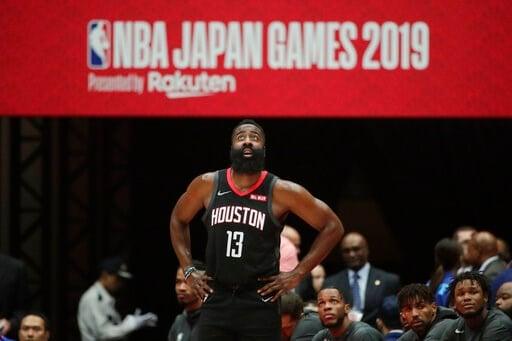(AP Photo/Jae C. Hong). Houston Rockets' James Harden stands near the team bench during the first half of an NBA preseason basketball game against the Toronto Raptors Tuesday, Oct. 8, 2019, in Saitama, near Tokyo.
