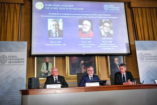 (Claudio Bresciani / TT via AP). Goran K Hansson, centre, Secretary General of the Royal Swedish Academy of Sciences, and academy members Mats Larsson, left, and Ulf Danielsson, announce the winners of the 2019 Nobel Prize in Physics, during news confe...