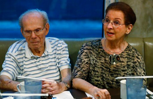 (AP Photo/Wilfredo Lee). In this, Monday, Oct. 7, 2019 photo, Vera Karliner, right, speaks during an interview with The Associated Press in Aventura, Fla., along with her husband Herb, left, who was on the ship named the St. Louis that was full of Jewi...