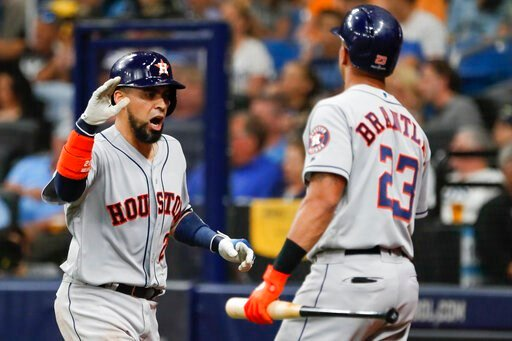 (AP Photo/Scott Audette). Houston Astros' Robinson Chirinos, left, celebrates his home run against the Tampa Bay Rays with Michael Brantley (23) during the eighth inning of Game 4 of a baseball American League Division Series, Tuesday, Oct. 8, 2019, in...