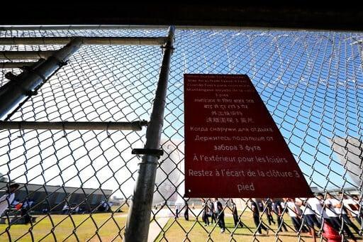 (AP Photo/Gerald Herbert). Detainees participate in outdoor recreational activities inside the Winn Correctional Center in Winnfield, La., Thursday, Sept. 26, 2019.
