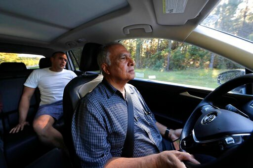 (AP Photo/Gerald Herbert). Pedro Cordoves Diaz, a 26-year-old from Cuba who was just released from the Winn Correctional Center, rides in the taxi of Alex Melendez to a bus station over 55 miles away, in Winnfield, La., Thursday, Sept. 26, 2019. Calls ...