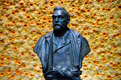 (Henrik Montgomery/Pool Photo via AP, File). FILE - In this Monday, Dec. 10, 2018 file photo, a bust of the Nobel Prize founder, Alfred Nobel on display at the Concert Hall during the Nobel Prize award ceremony in Stockholm. Controversy stalks the Nobe...
