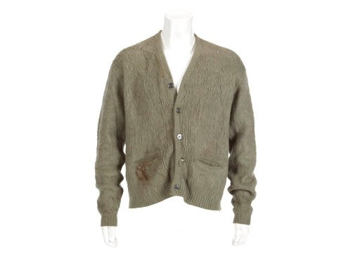 """(Julien's Auctions via AP). This image released by Julien's Auctions shows an olive green cardigan sweater worn by Nirvana frontman Kurt Cobain during Nirvana's MTV's """"Unplugged"""" performance. The sweater, along with Cobain's custom Fender guitar, are a..."""
