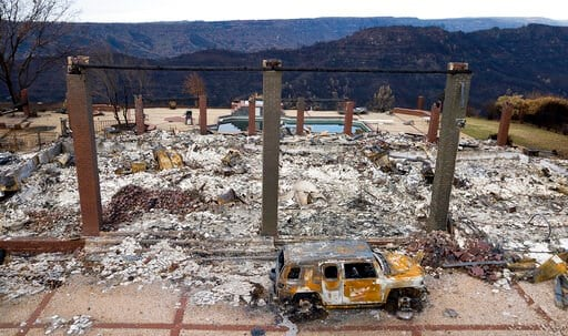 (AP Photo/Noah Berger, File). FILE - In this Dec. 3, 2018, file photo, a vehicle rests in front of a home leveled by the Camp Fire in Paradise, Calif. Two years to the day after some of the deadliest wildfires tore through Northern California wine coun...
