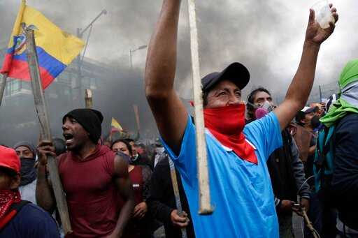 (AP Photo/Dolores Ochoa). Anti-government protesters, including indigenous people, clash with police near the National Assembly in Quito, Ecuador, Tuesday, Oct. 8, 2019. Anti-government protests, which began when President Lenín Moreno's decision to cu...