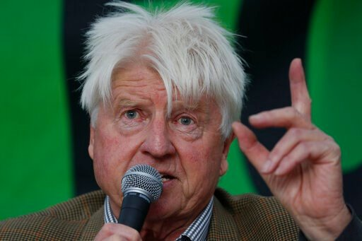 (AP Photo/Alastair Grant). Stanley Johnson, father of the British Prime Minister Boris Johnson, speaks at an Extinction Rebellion panel on climate change in Trafalgar Square, on the third day of ongoing demonstrations in London, Wednesday, Oct. 9, 2019...
