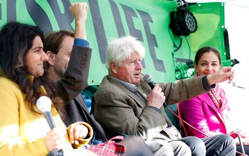 (AP Photo/Alastair Grant). Stanley Johnson, second right, father of the British Prime Minister Boris Johnson, speaks at an Extinction Rebellion panel on climate change in Trafalgar Square, on the third day of ongoing demonstrations in London, Wednesday...