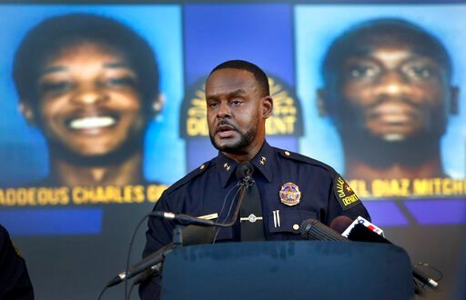(Tom Fox/The Dallas Morning News via AP). Dallas Assistant Chief of Police Avery Moore addresses the media about a drug deal gone bad resulting in the death of Joshua Brown. The police are still looking for suspects Thaddeous Charles Green and Michael ...