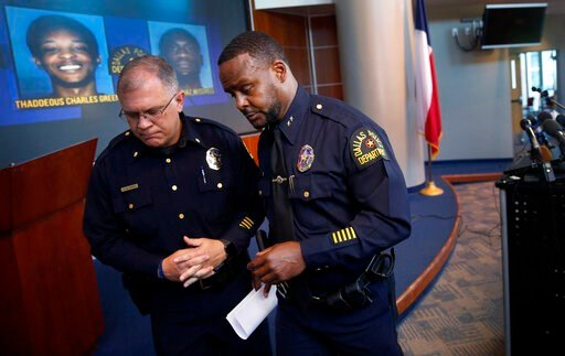 (Tom Fox/The Dallas Morning News via AP). Dallas Assistant Chief of Police Avery Moore, right, walks away from the podium after addressing the media about a drug deal gone bad, resulting in the death of Joshua Brown at Dallas Police Headquarters in Dal...