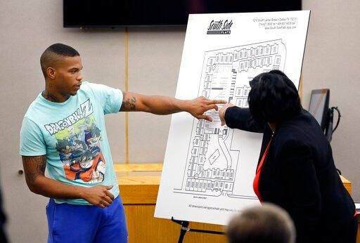 (Tom Fox/The Dallas Morning News via AP, Pool). In this Tuesday, Sept. 24, 2019, photo, victim Botham Jean's neighbor Joshua Brown, left, answers questions from Assistant District Attorney LaQuita Long, right, while pointing to a map of the South Side ...