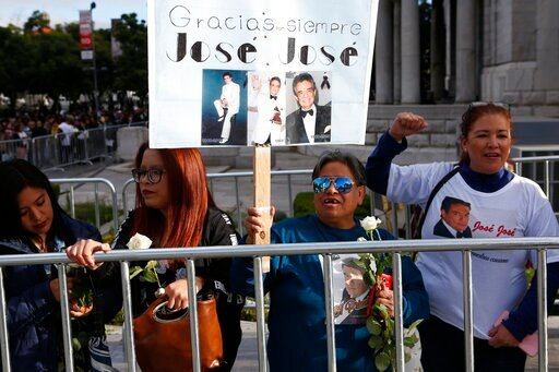 (AP Photo/Ginnette Riquelme). Fans waits outside the Palace of Fine Arts to say farewell to the ashes of Mexican singer Jose Jose, in Mexico City, Wednesday, Oct 9, 2019. Jose Jose died Sept. 28 in South Florida. His body was cremated in Miami, and it ...