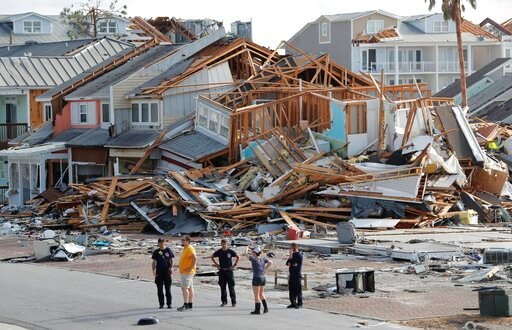 (AP Photo/Gerald Herbert, File). FILE- In this Oct. 11, 2018 file photo, rescue personnel perform a search in the aftermath of Hurricane Michael in Mexico Beach, Fla. A year after Hurricane Michael, Bay County, Florida, is still in crisis. Thousands ar...