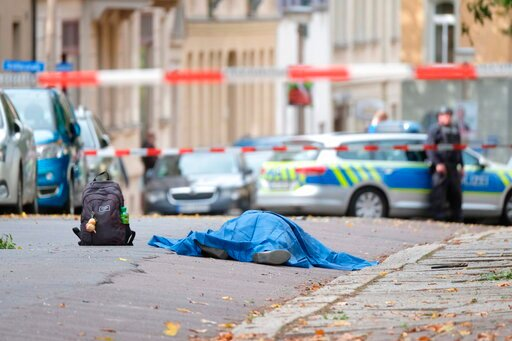 (Sebastian Willnow/dpa via AP). A body lies on a road in Halle, Germany, Wednesday, Oct. 9, 2019 after a shooting incident. A gunman fired several shots on Wednesday in German city of Halle and at least two got killed, according to local media FOCUS on...