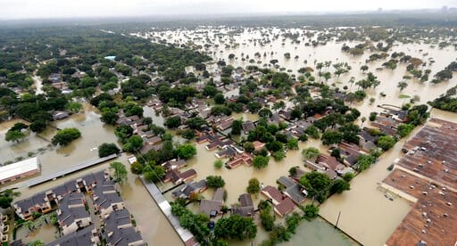(AP Photo/David J. Phillip, File). FILE - In this Aug. 29, 2017, file photo, a neighborhood near Addicks Reservoir is flooded by rain from Tropical Storm Harvey in Houston. A new study finds that FEMA buys flood-prone homes more often in wealthy, popul...