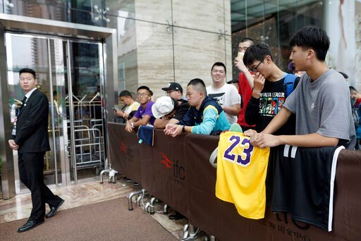 (AP Photo). Chinese basketball fans gather outside of a hotel for a press conference that was later postponed ahead of an NBA preseason basketball game on Thursday between the Los Angeles Lakers and Brooklyn Nets in Shanghai, China, Wednesday, Oct. 9, ...