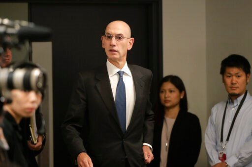 (AP Photo/Jae C. Hong). NBA Commissioner Adam Silver arrives for a news conference before an NBA preseason basketball game between the Houston Rockets and the Toronto Raptors Tuesday, Oct. 8, 2019, in Saitama, near Tokyo.
