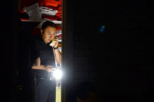 (Alan Dep/Marin Independent Journal via AP). Daniel Almanza of Bayside Cafe, which was among businesses to lose power due to PG&E's public safety power shutoff, calls a supplier from the office of the restaurant in Sausalito, Calif., Wednesday, Oct...