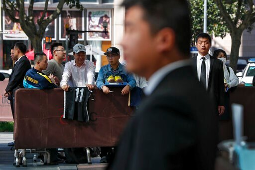 (AP Photo/Andy Wong). Chinese security officers stand guard as fans carrying jerseys and shoes wait for NBA players to autograph outside the Ritz-Carlton hotel in Shanghai, China, Thursday, Oct. 10, 2019. NBA Commissioner Adam Silver told the Brooklyn ...