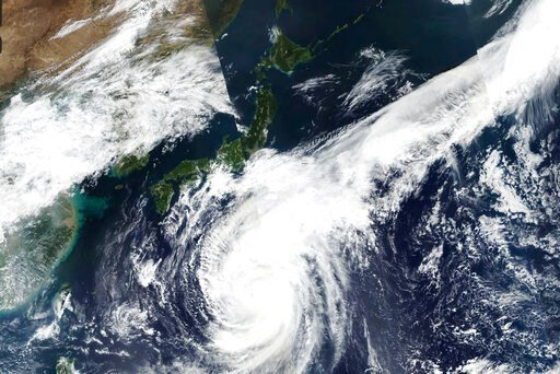 (EOSDIS) via AP). This Oct. 10, 2019, satellite photo taken by NASA-NOAA's Suomi NPP satellite shows typhoon Hagibis approaching Japan, center left.  Japan's weather agency is warning a powerful typhoon may bring torrential rains to central Japan over ...