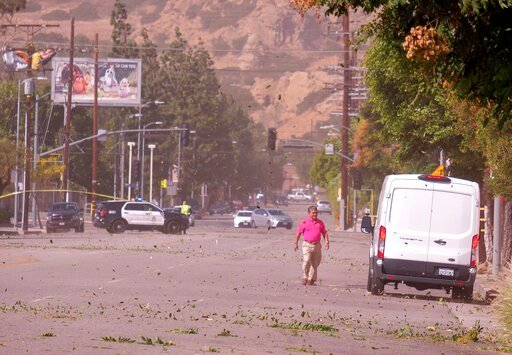 (Dean Musgrove/The Orange County Register via AP). Strong Santa Ana winds in Chatsworth, Calif., blew across power lines causing them to arc and transformers to explode. Power was out for street signs, businesses and residents along Devonshire St. from...