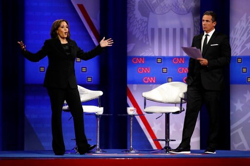 (AP Photo/Marcio Jose Sanchez). Democratic presidential candidate Sen. Kamala Harris, D-Calif., answers a question as CNN moderator Chris Cuomo listens during the Power of our Pride Town Hall Thursday, Oct. 10, 2019, in Los Angeles. The LGBTQ-focused t...