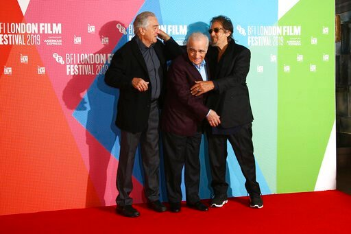 (Photo by Joel C Ryan/Invision/AP). Actor Al Pacino, from right, director Martin Scorsese and actor Robert De Niro pose for photographers at the photocall of the film 'The Irishman' as part of the London Film Festival, in central London, Sunday, Oct. 1...