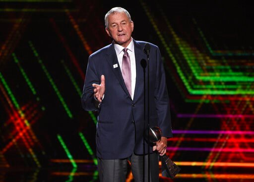 (Photo by Chris Pizzello/Invision/AP, File). FILE - In this July 10, 2019 file photo, Jim Calhoun, men's basketball coach for the University of Saint Joseph in West Hartford, Conn., accepts the best coach award at the ESPY Awards at the Microsoft Theat...