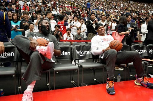 (AP Photo/Jae C. Hong). Houston Rockets' James Harden, left, and Russell Westbrook share a light moment during warmups for the team's NBA preseason basketball game against the Toronto Raptors Thursday, Oct. 10, 2019, in Saitama, near Tokyo.