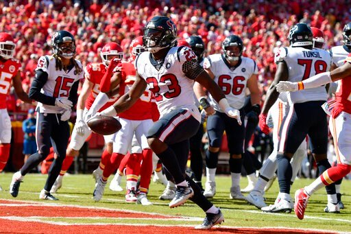 (AP Photo/Ed Zurga). Houston Texans running back Carlos Hyde (23) scores a touchdown during the first half of an NFL football game against the Kansas City Chiefs in Kansas City, Mo., Sunday, Oct. 13, 2019.