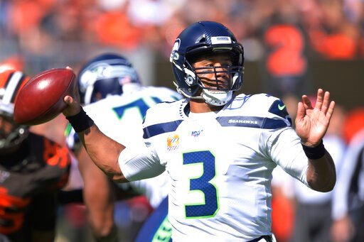 (AP Photo/David Richard). Seattle Seahawks quarterback Russell Wilson looks to pass during the first half of an NFL football game against the Cleveland Browns, Sunday, Oct. 13, 2019, in Cleveland.