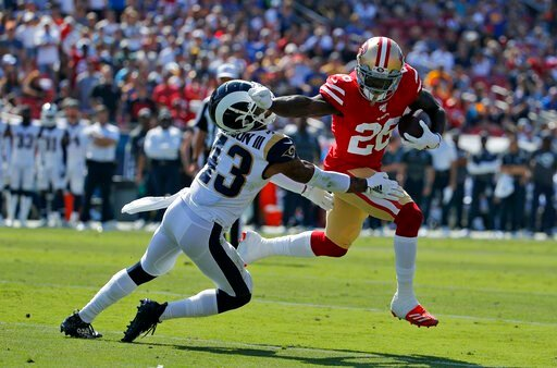 (AP Photo/John Locher ). San Francisco 49ers running back Tevin Coleman (26) runs around Los Angeles Rams strong safety John Johnson (43) to score a touchdown during the first half of an NFL football game Sunday, Oct. 13, 2019, in Los Angeles.