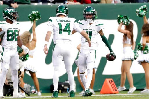 (AP Photo/Adam Hunger). New York Jets quarterback Sam Darnold (14) celebrates a touchdown with Robby Anderson (11) during the first half of an NFL football game against the Dallas Cowboys, Sunday, Oct. 13, 2019, in East Rutherford, N.J.