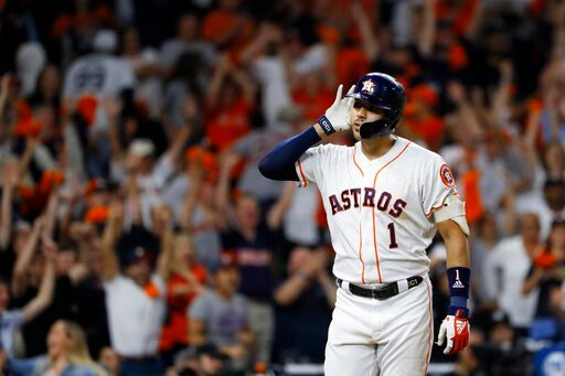 (AP Photo/Matt Slocum). Houston Astros shortstop Carlos Correa celebrates after his walk-off home run against the New York Yankees during the 11th inning in Game 2 of baseball's American League Championship Series Monday, Oct. 14, 2019, in Houston.