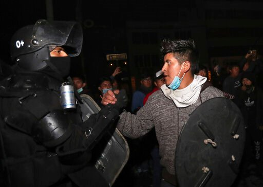 (AP Photo/Dolores Ochoa). One of the protesters shakes hands with a security officer as they celebrate the announcement that the government cancelled an austerity package that triggered violent protests, in Quito, Ecuador, Sunday, Oct. 13, 2019. Ecuado...