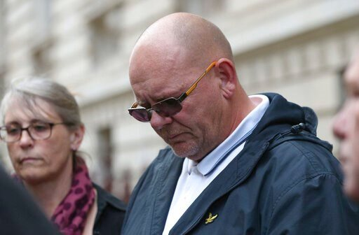 (Jonathan Brady/PA via AP). The father Harry Dunn, Tim Dunn, leaves the Foreign and Commonwealth Office in London, where the family members met British Foreign Secretary Dominic Raab, Wednesday Oct. 9, 2019.  19-year old Harry Dunn was killed in a road...