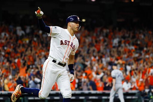 (AP Photo/Matt Slocum). Houston Astros' Carlos Correa celebrates with teammates after his walk-off home run against the New York Yankees during the 11th inning in Game 2 of baseball's American League Championship Series Sunday, Oct. 13, 2019, in Houston.