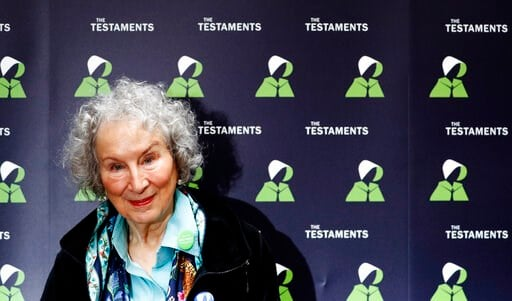 (AP Photo/Alastair Grant, File). FILE - In this Tuesday, Sept. 10, 2019 file photo, Canadian author Margaret Atwood poses for a photograph during a press conference at the British Library to launch her new book 'The Testaments' in London. Booker Prize ...