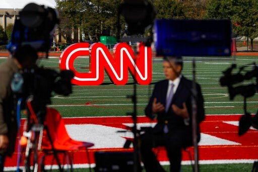 (AP Photo/John Minchillo). A journalist records video near a CNN sign on an athletic field outside the Clements Recreation Center where the CNN/New York Times will host the Democratic presidential primary debate at Otterbein University, Monday, Oct. 14...